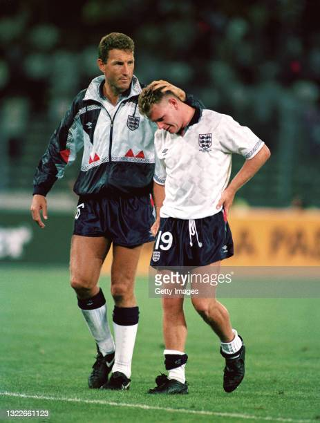 England player Paul Gascoigne is consoled by Terry Butcher after the 1990 FIFA World Cup Semi Final between England and West Germany at Stadio delle...