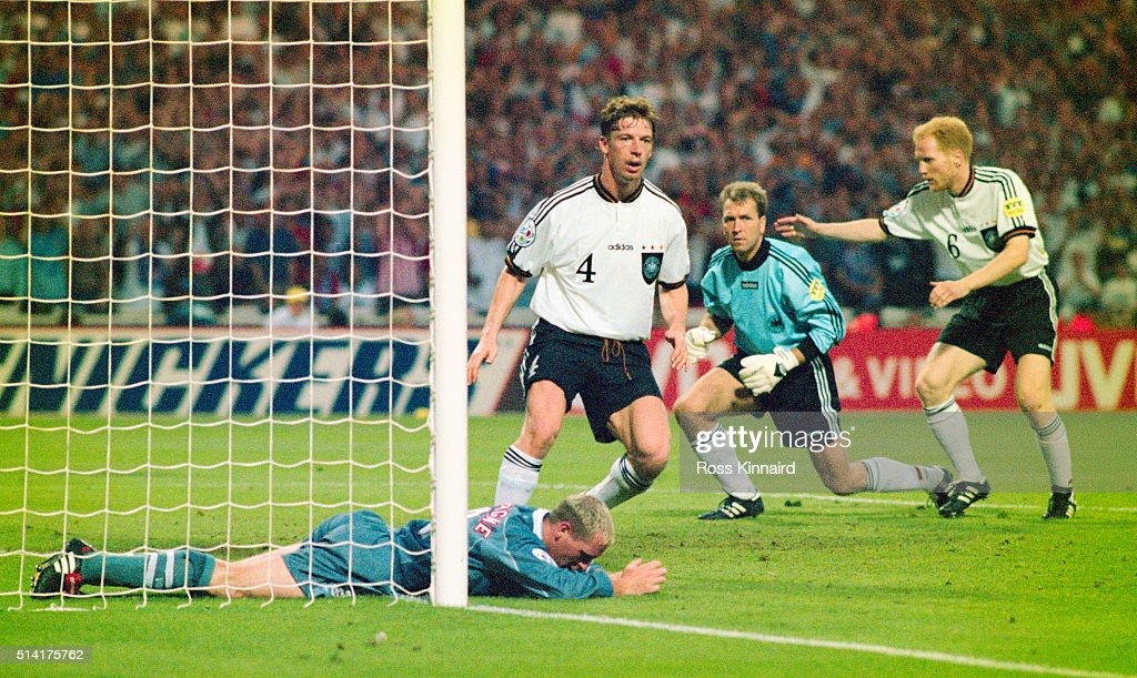England player Paul Gascoigne reacts after failing to convert a cross as Germany players (left to right) Steffen Freund, Andreas Köpke and Matthias Sammer look on during the 1996 UEFA European Championships semi final match between England and Germany at Wembley Stadium on June 26, 1996 in London, England.