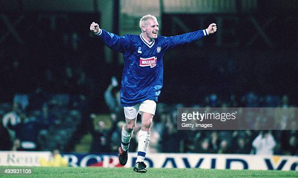 England player Paul Gascoigne wearing a Leicester shirt celebrates a goal during a testimonial match for ex Leicester City player Steve Walsh against...