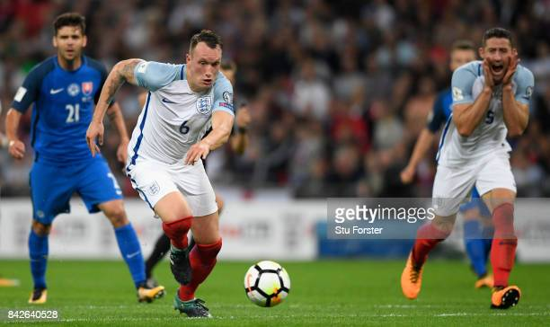 England player Phil Jones in action as Gary Cahill reacts during the FIFA 2018 World Cup Qualifier between England and Slovakia at Wembley Stadium on...
