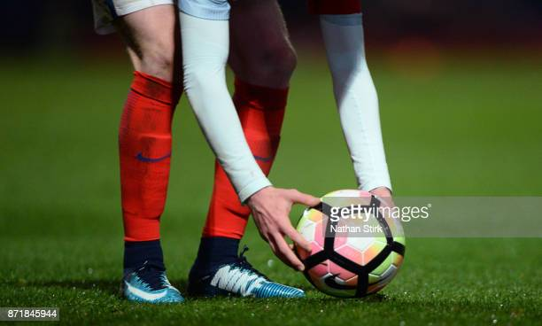 England player places the ball for a free kick during the International Match between England U17 and Portugal U17 at Proact Stadium on November 8...