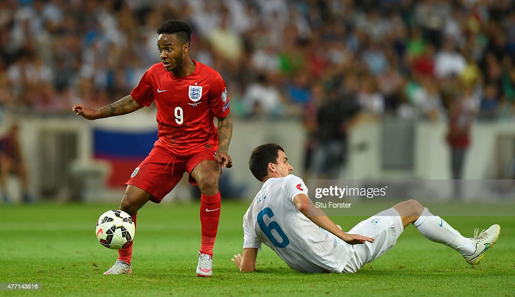 England player Raheem Sterling skips past Branko Ilic of Slovenia during the UEFA EURO 2016 Qualifier between Slovenia and England on at the Stozice Arena on June 14, 2015 in Ljubljana, Slovenia.