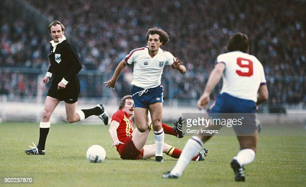 England player Ray Wilkins skips the challenge of John Mahony of Wales during the goaless draw in the British Home International Championships match...