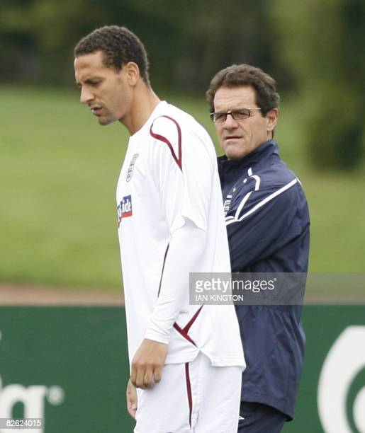 England player Rio Ferdinand is pictured with England Manager Fabio Capello during a training session at Arsenal's training facility in London...