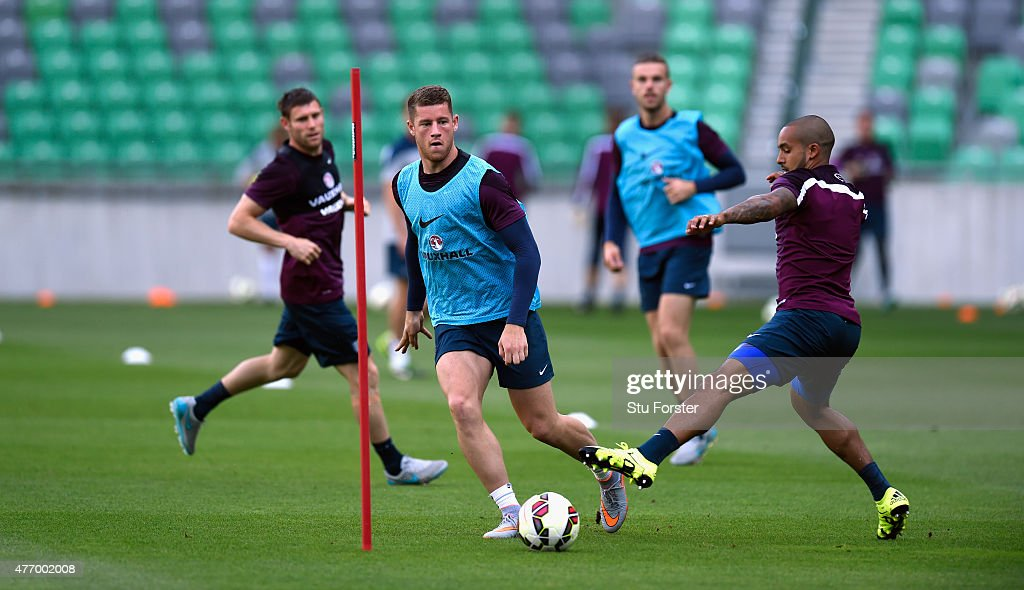 England player Ross Barkley (c) is challenged by Theo Walcott (r) during England Training and Press Conference prior to sunday's UEFA EURO 2016 Qualifier between Slovenia and England at Stozice on June 13, 2015 in Ljubljana, Slovenia.