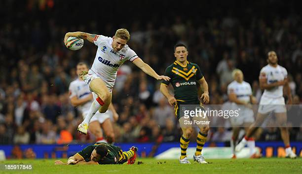 England player Sam Tomkins hurdles the tackle of Billy Slater during the Rugby League World Cup Group A match between Australia and England at...