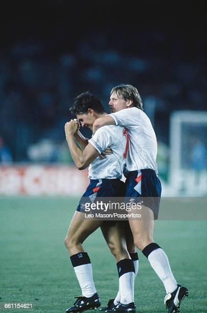 England player Stuart Pearce hugs teammate Gary Lineker after Lineker scored a penalty during the 1990 FIFA World Cup quarterfinal game between...