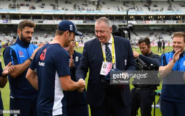 England player Toby Roland Jones is presented with his cap by Angus Fraser before the 3rd Royal London Cup match between England and South Africa at...