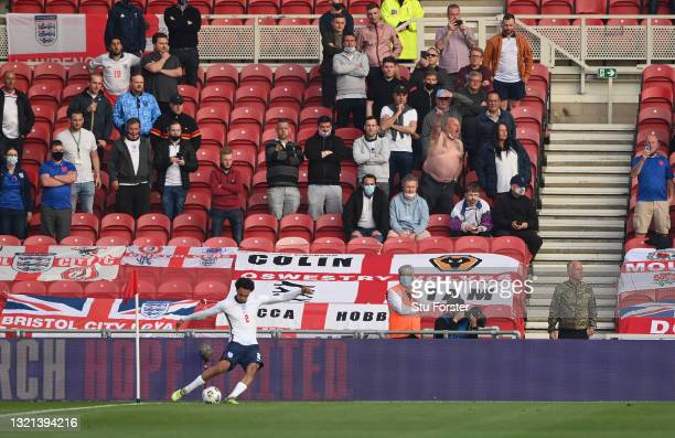 England player Trent Alexander-Arnold takes a corner kick watched by the England fans during the international friendly match between England and...