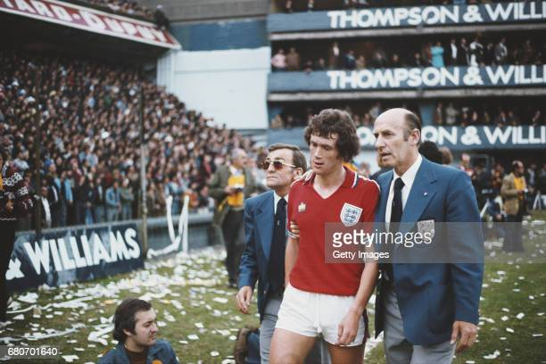 England player Trevor Cherry is led off by FA officials in his red admiral away kit after being sent off with Daniel Bertoni of Argentina during the...
