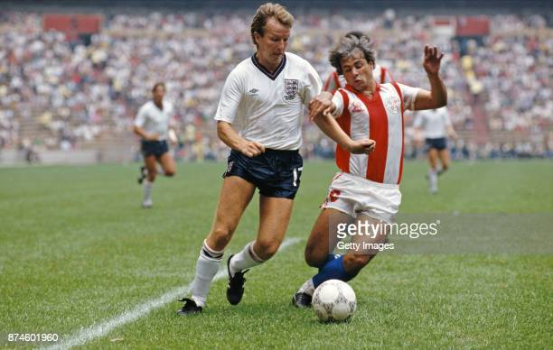 England player Trevor Steven is challenged by Paraguay player Jorge Amado Nunez during the FIFA World Cup Finals 2nd Round match at Azteca Stadium on...