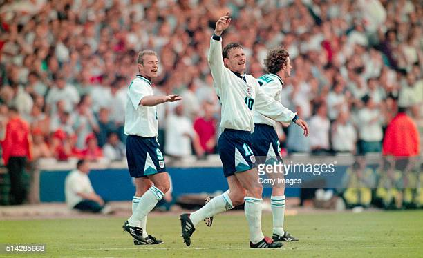 England players Alan Shearer and Steve McManaman celebrate with goalscorer Teddy Sheringham after he had scored the second goal during the 1996...