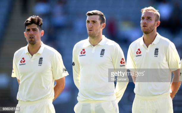 England players Alastair Cook Craig Overton and Stuart Broad sing the national anthem before day one of the First Test Match between the New Zealand...