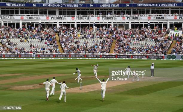 England players and fans celebrate after bowler Ben Stokes had taken the wicket of Virat Kohli during day 4 of the First Specsavers Test Match...