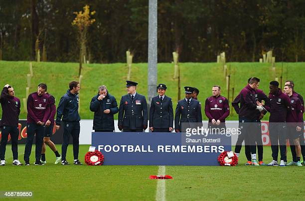 England players and staff and members of the Armed Forces lineup for the Armistice Day silence during an England training session ahead of the UEFA...