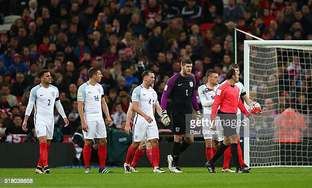 England players argue with referee Antonio Miguel Mateu Lahoz after the second Netherlands goal scored by Luciano Narsingh during the International...