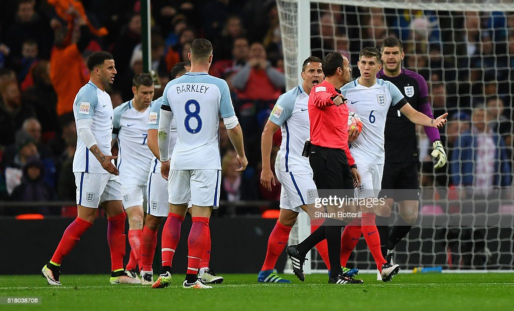 England players argue with referee Antonio Miguel Mateu Lahoz after the second Netherlands goal scored by Luciano Narsingh during the International Friendly match between England and Netherlands at Wembley Stadium on March 29, 2016 in London, England.