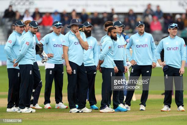 ENgland players await a review decision after England's Jonny Bairstow celebrates dismissed Sri Lanka's Dushmantha Chameera during the third one-day...