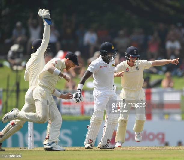England players Ben Foakes Ben Stokes and Keaton Jennings celebrate the dismissal of Angelo Matthews during Day Two of the Second Test match between...