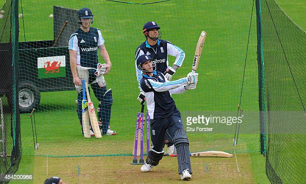 England players Ben Stokes and Alastair Cook look on as batsman Alex Hales hits out during England practice ahead of Wednesday's 2nd One Day...