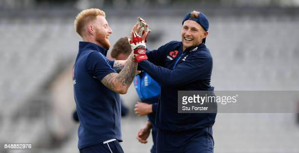 England players Ben Stokes and Joe Root celebrate a goal during a game of football during England nets ahead of the 1st ODI against West Indies at...