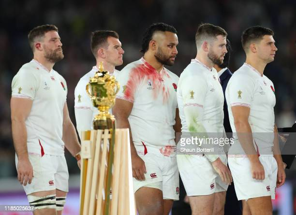 England players Ben Youngs Elliot Daly Billy Vunipola Ben Spencer and Mark Wilson walk past the Webb Ellis Trophy after the Rugby World Cup 2019...