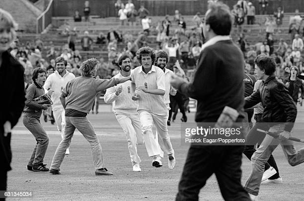 England players Bob Willis Graham Gooch Peter Willey and Mike Gatting run from the pitch after England had won the 3rd Test match between England and...