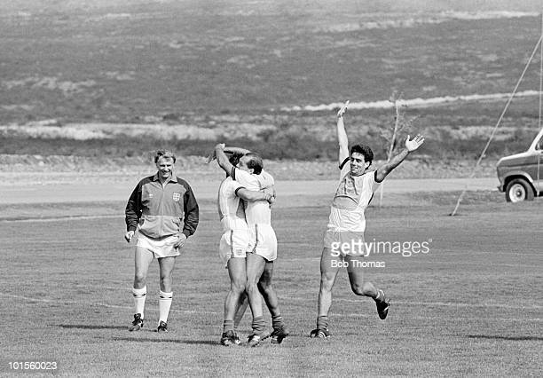 England players Bryan Robson Ray Wilkins and Gary Stevens celebrate one of England's goals whilst referee Bobby Robson looks on during a preWorld Cup...