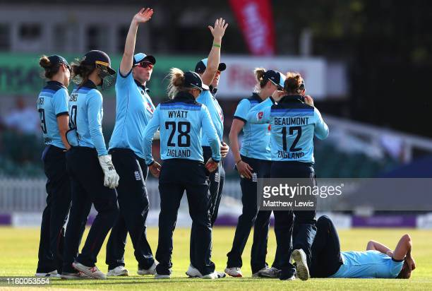 England players call for the medical team as Katherine Brunt of England injures herself whilst celebrating bowling Meg Lanning of Australia during...