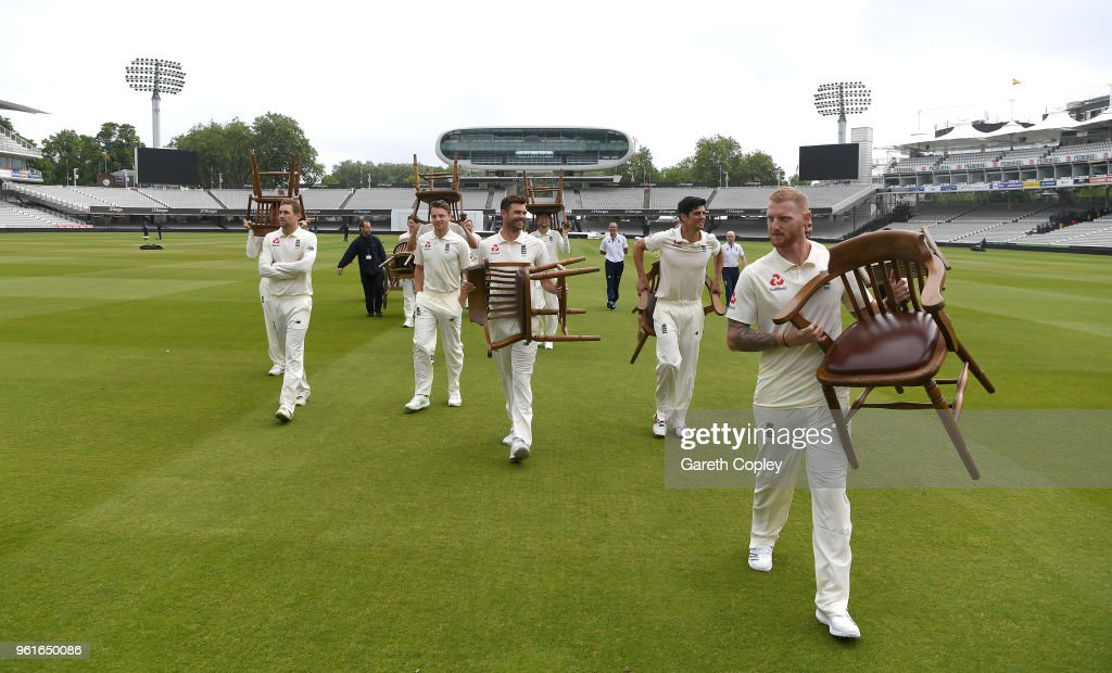 England players carry their chairs back to the pavilion after their team picture at Lord's Cricket Ground on May 23, 2018 in London, England.