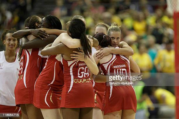 England players celebrate after defeating Jamaica in the 3rd v 4th match on day eight of the 2011 World Netball Championships at Singapore Indoor...