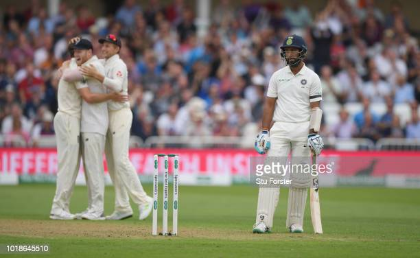 England players celebrate after dismissing India batsman Cheteshwar Pujara during day one of the 3rd Specsavers Test Match between England and India...