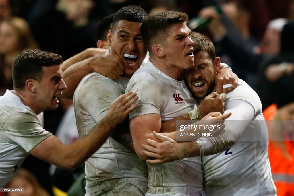 TOPSHOT - England players celebrate after England's wing Elliot Daly (R) scored their second try during the Six Nations international rugby union match between Wales and England at the Principality Stadium in Cardiff, south Wales, on February 11, 2017. / AFP PHOTO / Adrian DENNIS / RESTRICTED TO EDITORIAL USE. Use in books subject to Welsh Rugby Union (WRU) approval.