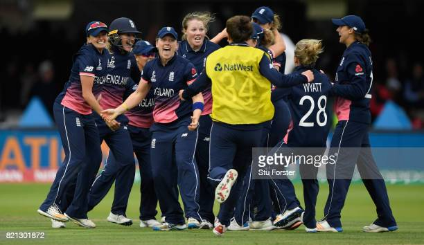 England players celebrate after the fall of the final wicket during the ICC Women's World Cup 2017 Final between England and India at Lord's Cricket...