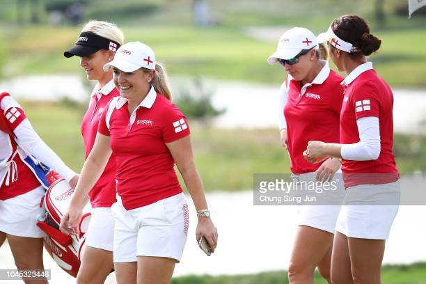 England players celebrate after the Pool A match between England and Australia on day one of the UL International Crown at Jack Nicklaus Golf Club on...