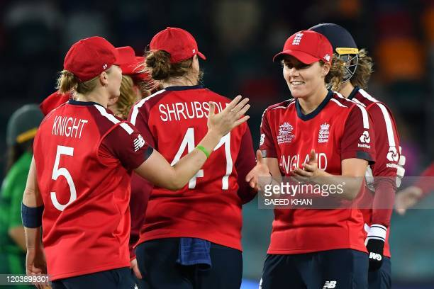 England players celebrate after their victory against Pakistan during the Twenty20 women's World Cup cricket match between Pakistan and England in...