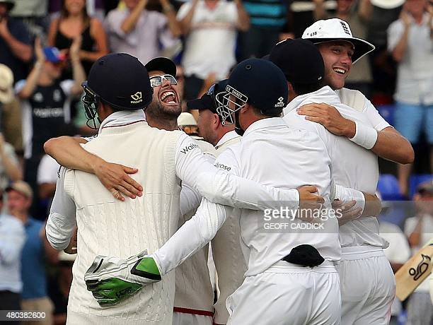 England players celebrate after winning the game on the fourth day of the opening Ashes cricket test match between England and Australia at The...