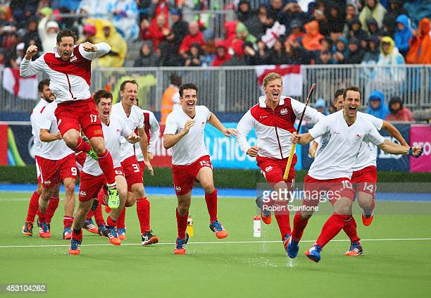 England players celebrate as they win bronze after a shoot out in the bronze medal match between New Zealand and England at Glasgow National Hockey...