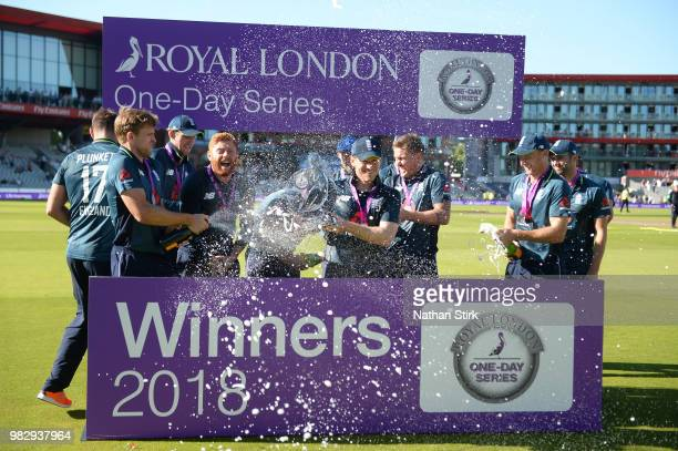 England players celebrate as they win the 5th Royal London ODI match between England and Australia at Emirates Old Trafford on June 24 2018 in...