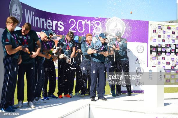England players celebrate during the 5th Royal London ODI match between England and Australia at Emirates Old Trafford on June 24 2018 in Manchester...