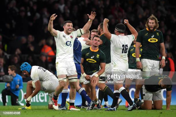England players celebrate following the final whistle during the Quilter International match between England and South Africa at Twickenham Stadium...