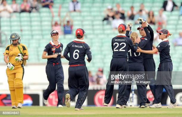 England players celebrate taking the wicket of Australia's Shelley Nitschke during the ICC Women's World Twenty20 Semi Final at The Oval London