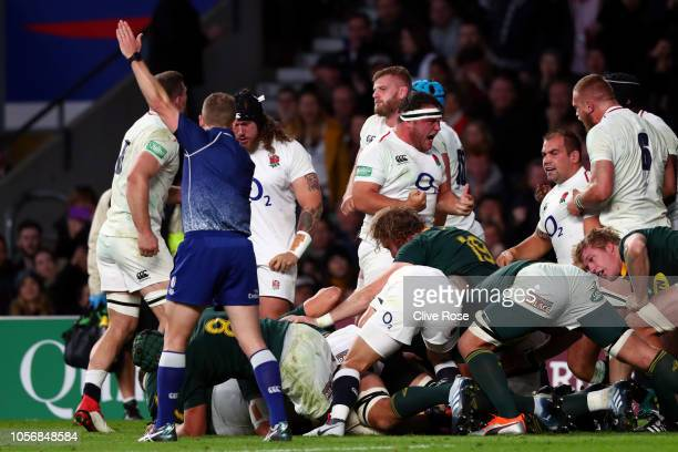 England players celebrate the collapse of the scrum on the South Africa try line to give England a penalty kick during the Quilter International...