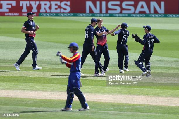 England players celebrate the dismissal of Jurgen Linde of Namibia during the ICC U19 Cricket World Cup match between England and Namibia at John...