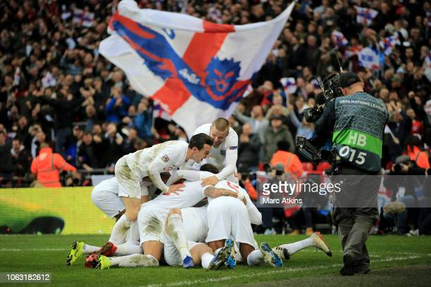 England players celebrate the late winner from Harry Kane during the UEFA Nations League A group four match between England and Croatia at Wembley...