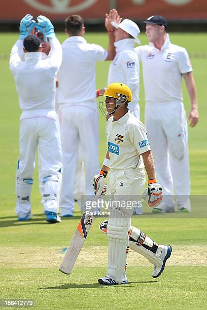 England players celebrate the wicket of Marcus Harris off the bowling of James Anderson of England during day one of the Tour match between Western...