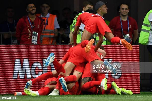 TOPSHOT England players celebrate their second goal during the Russia 2018 World Cup Group G football match between Tunisia and England at the...