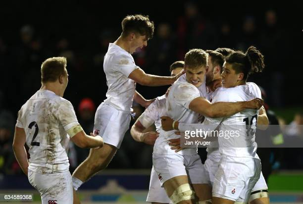 England players celebrate their second try during the U20 Six Nations match between Wales U20 and England U20 at Eirias Stadium on February 10 2017...