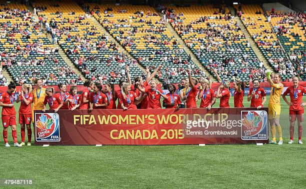 England players celebrate their third place after the FIFA Women's World Cup Canada 2015 Third Place Play-off match between Germany and England at...