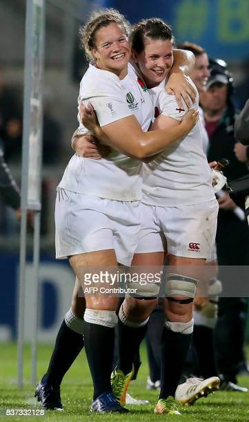England players celebrate victory after the Women's Rugby World Cup 2017 semifinal match between England and France at The Kingspan Stadium in...